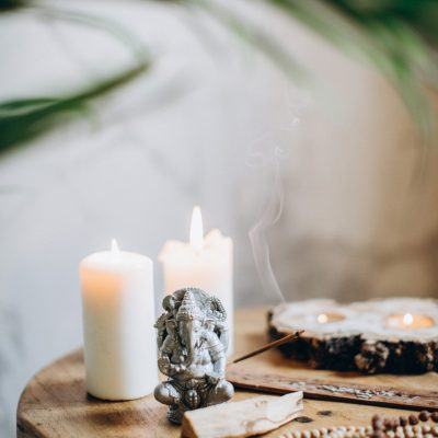brown-wooden-table-with-candles-and-incense-3822774