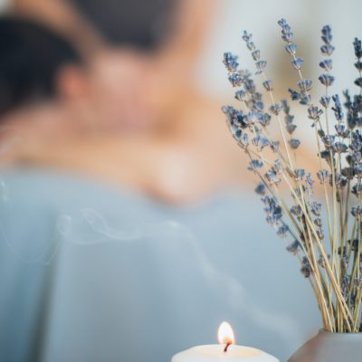 lavender-flowers-and-lighted-candle-3865794